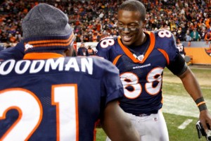 Denver Broncos' Thomas celebrates with teammate Goodman after the Broncos defeated the Pittsburgh Steelers on Thomas' touchdown during overtime in their NFL AFC wildcard playoff football game in Denver